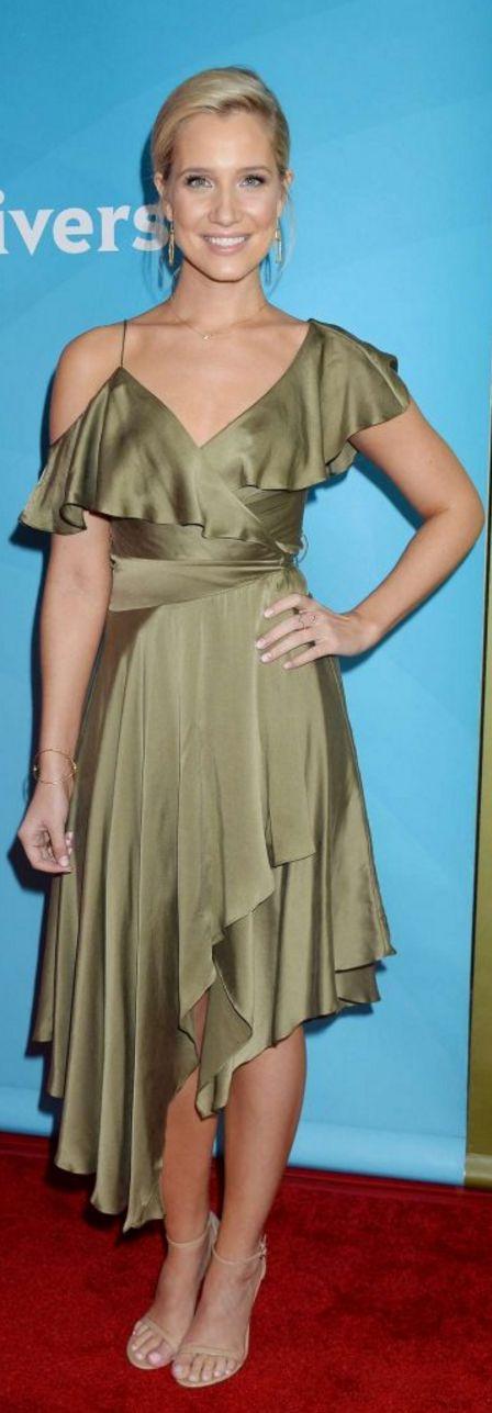 Who made Kristine Leahy's green ruffle warp dress and tan sandals?