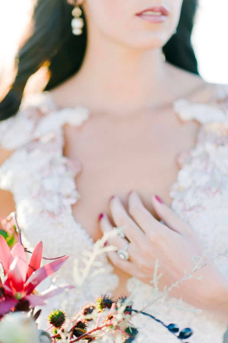 this is a good example of how even a small detail of the bouquet can add so much depth to a picture. You just see a tiny bit of the bouquet but it adds so much character