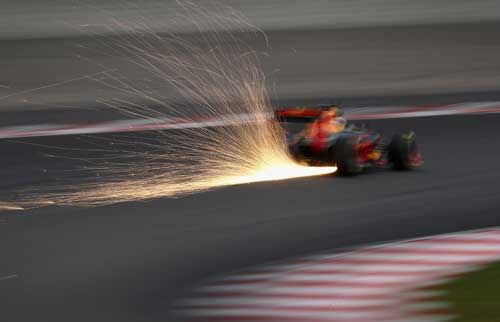 Sparks fly behind Daniel Ricciardo / Red Bull during qualifying for the Malaysia F1 Grand Prix at Sepang Circuit