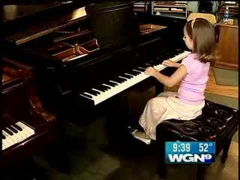 The Next Mozart? 6-Year Old Piano Prodigy Wows All. Emily Bear says that she's just a normal kid that plays the piano. She was discovered by her grandmother when she started playing a c-scale at the age of 2 years old. She plays music by other composers and writes her own music as well, and she loves the stuffed bunny that she got at the White House.