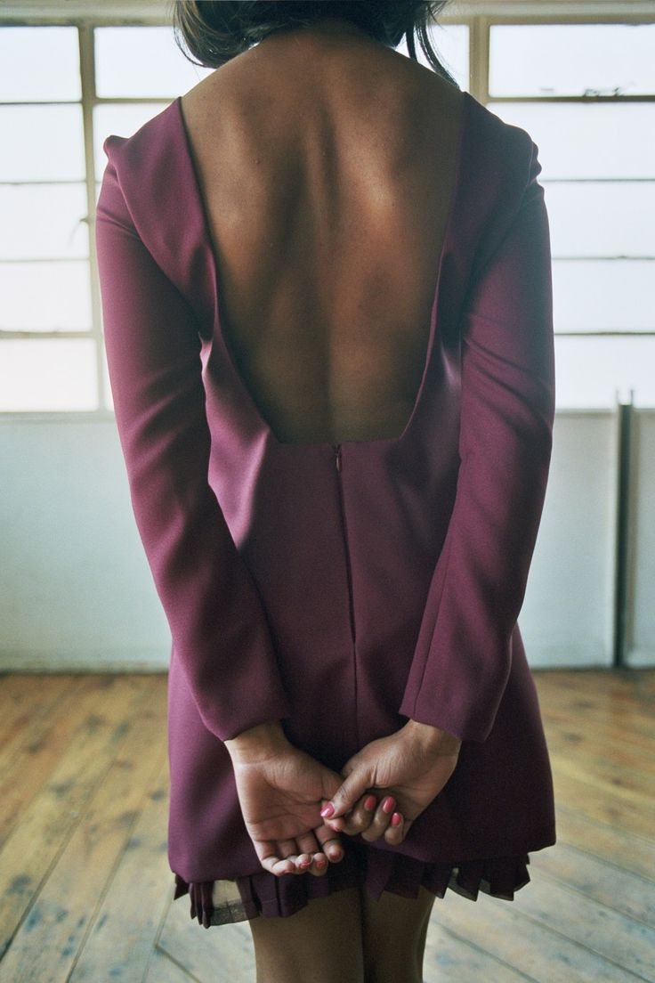 Yasmin - Burgundy crepe dress with backless detail and exposed chiffon pleated hem. Images copyright (c) Scarlett Cunningham. All rights reserved).