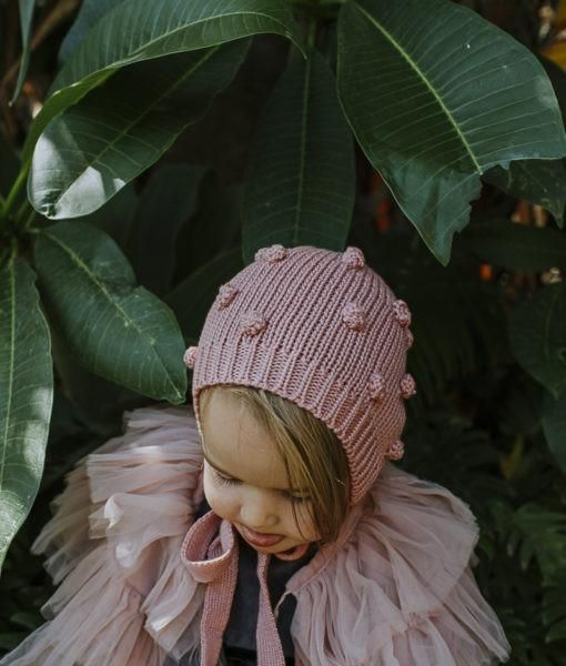 A beautiful knitted hat in our favourite bonnet style from Hubble & Dukes'AW17 collection. Featuring all over pompoms and knitted ties.