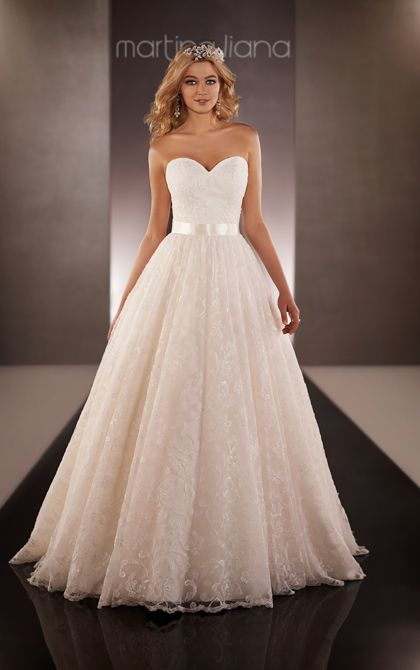 Royal Organza designer ball gown wedding dress from Martina Liana featuring a fitted sweetheart bodice and full skirt embellished with Lacey floral accents.
