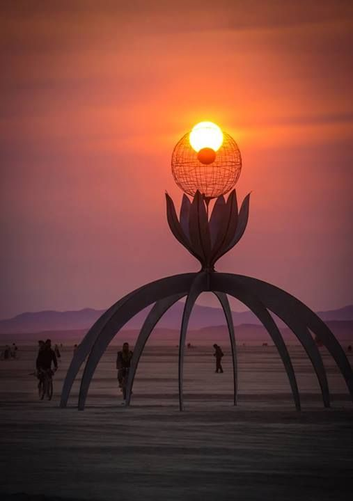 Photo by Dave Rimington at Burning Man 2013:  The Desert Flower with rising Sun.