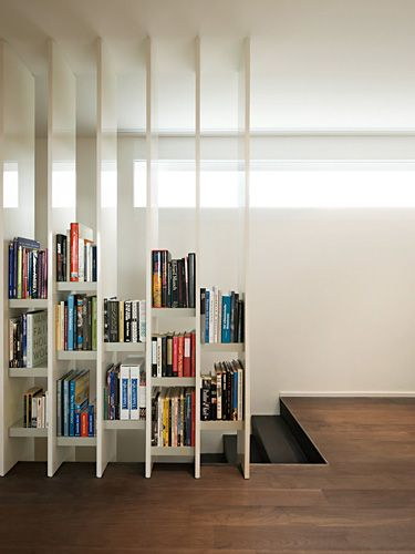 Very awesome use of book case to make a room divider