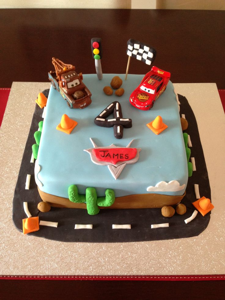 Cars cake for James' 4th Birthday. Lightening McQueen & Mater on top, not made by me. Only a days notice that he wanted a Cars cake! Made everything else on & in the cake!!