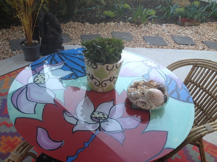 """I jazzed up an old glass table by painting the underside of the glass.  Now this piece sits quite """"zenly"""" outside of the entrance to our Yoga Shala!  Happy days!!"""