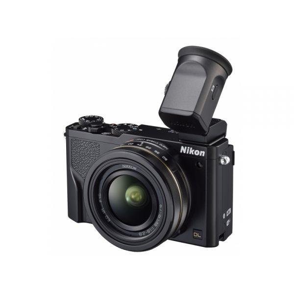 #NIKON DL18-50mm digitális #fényképezőgép.  Lenyűgöző f/1,8-as fényerő 18 mm-en: ez a Nikon DL készülék a Nikon által valaha készített legfényesebb ultranagy látószögű objektívet tartalmazza. Az objektíven a Nikon híres Nanokristály bevonata biztosít nagyobb képtisztaságot. A fényképezőgép egy 1,037 megapixeles, dönthető OLED-érintőképernyőt és beépített Perspektíva korrekciót is tartalmaz. Klasszikus fekete színben kapható.
