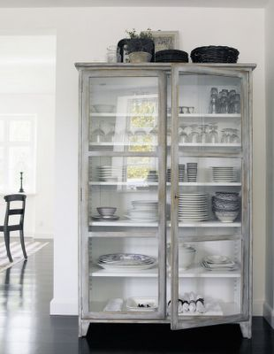 Cabinet in kitchen for decorative storage...love it!