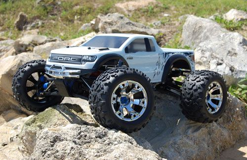 Lifted white Ford Raptor Truck