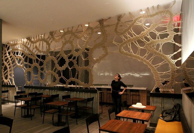 Giant lace installation at a restaurant.