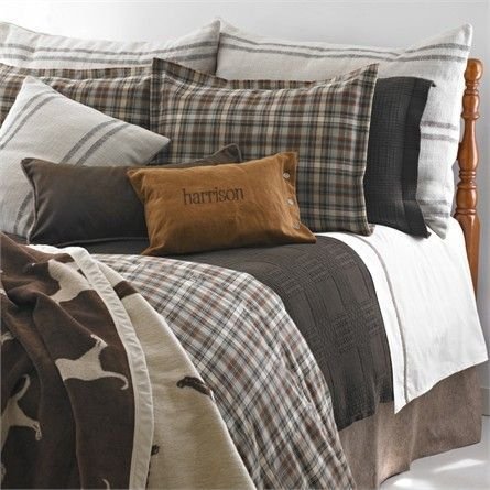 Give your man of any age a bedding collection that he is sure to love with the Harrison Bedding Collection from Traditions Linens. This rustic and masculine bedding collection features two different plaid patterns paired with warm shades of brown, red and gray