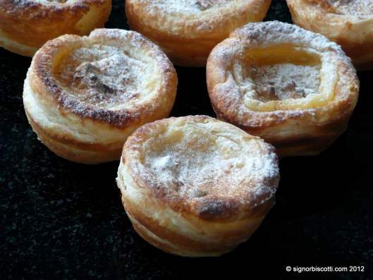 Pastéis de Nata Portuguese Custard Tarts Recipe: Pastel de nata is a Portuguese egg tart pastry, common in Portugal, the Lusosphere countries and regions (which include Brazil, Angola, Mozambique, Cape Verde, São Tomé and Príncipe, Guinea-Bissau, Timor-Leste, Goa, Malacca and Macau, introducing them later in Mainland China), and countries with significant Portuguese immigrant populations, Canada, Australia, Luxembourg,  United States, and France, among others.