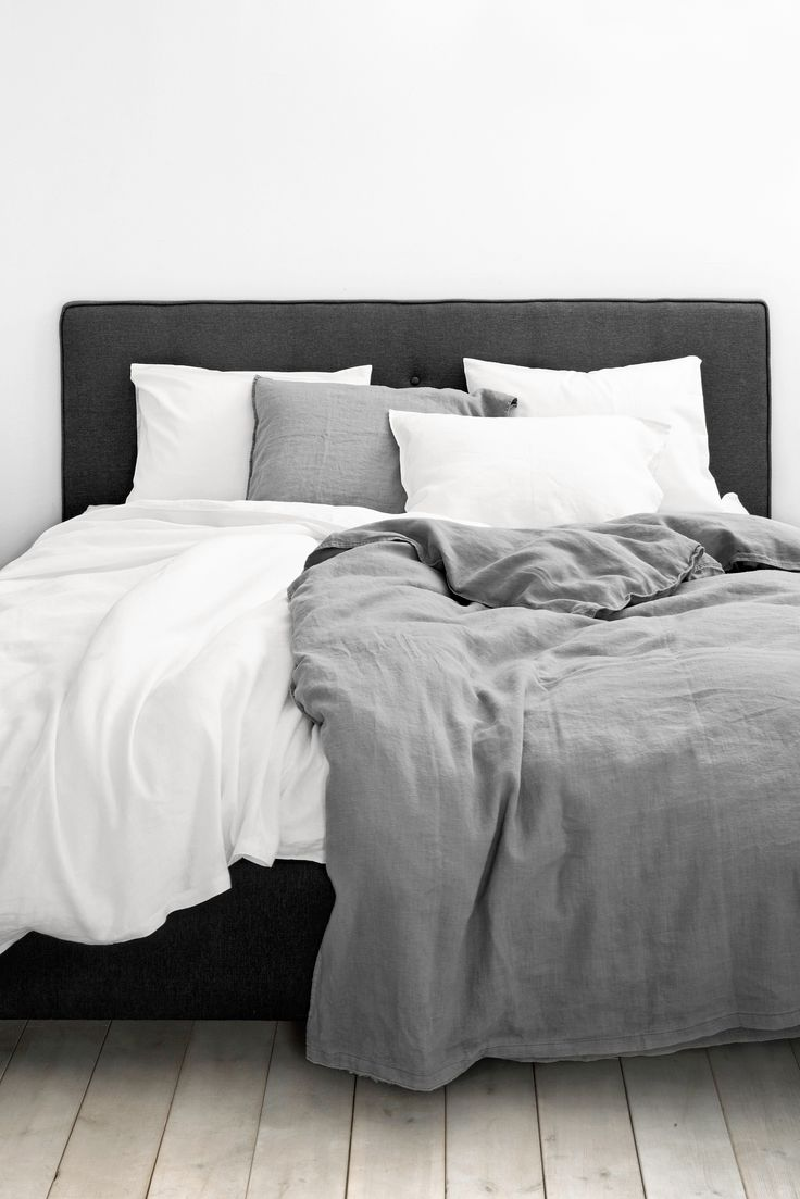 white grey bedding with charcoal almost black upholstery