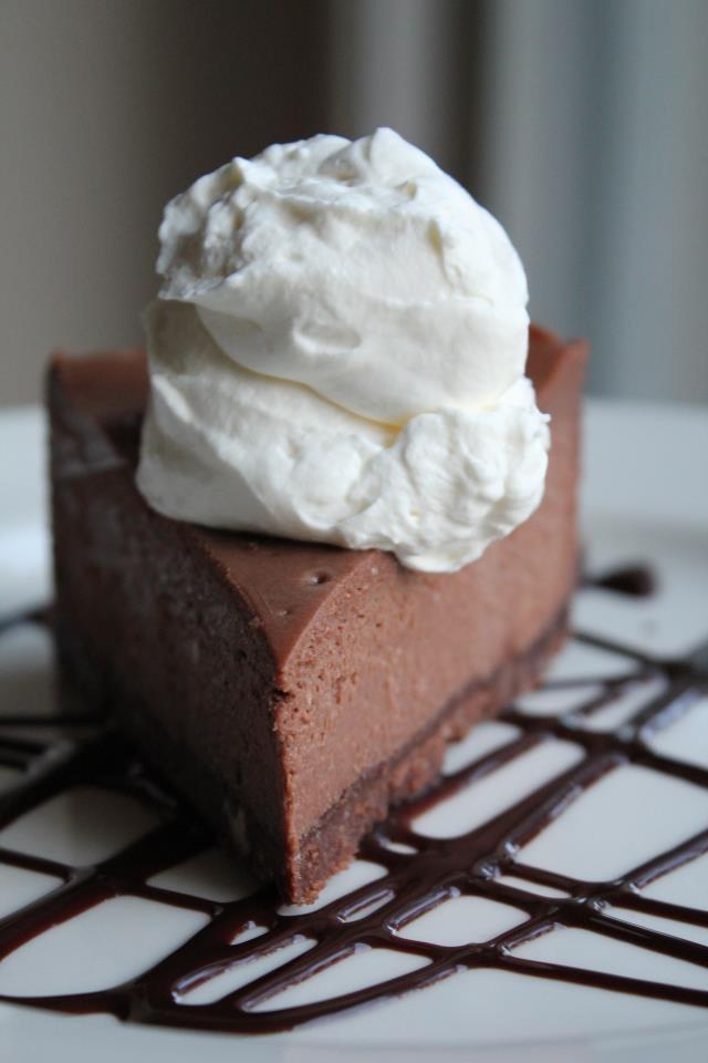 Fudge Truffle Cheesecake with Fresh Whipped Cream and Chocolate Sauce
