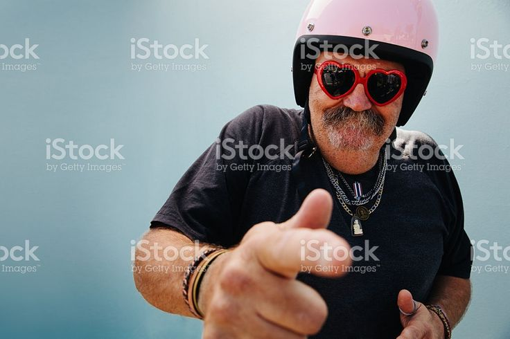 Funny grandpa with pink helmet and heart sunglasses royalty-free stock photo