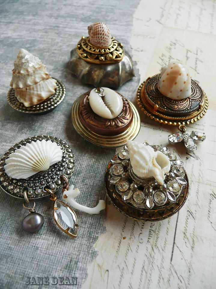 Wow - how cool are these - vintage pill boxes onto which seashells were glued and charm embellishments were attached.