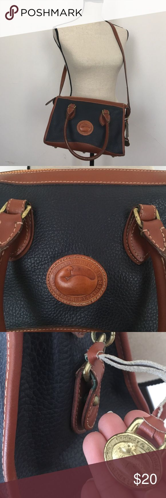Vintage Dooney and Bourke navy purse Non adjustable removable cross body strap.  Inside is in great condition.  Please see pictures for condition. I don't think the zipper and cross body strap are original.  Price reflects this. Dooney & Bourke Bags