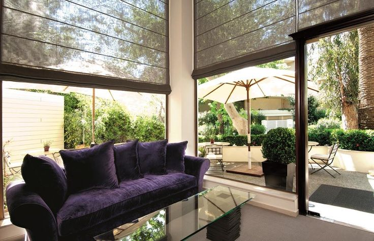 Kefalari Suites lobby, overlooking the beautiful yard! #Kefalari #Suites #hotel #Athens #luxury #beautiful #yard #sunny #day