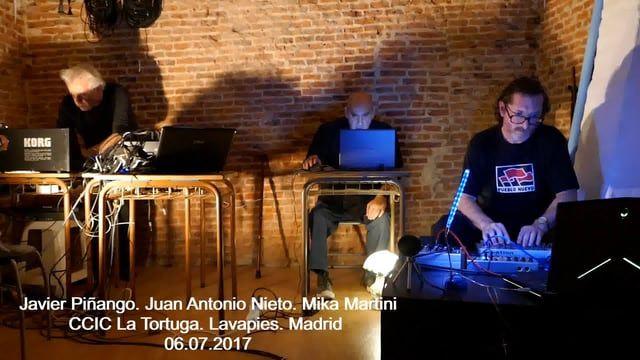Intervención final conjunta  en el CCIC la Tortuga de Lavapies en Madrid el pasado día 6 de julio de 2017 de Javier Piñango, Juan Antonio Nieto y Mika Martini.  RauLuz 2018    http://www.centrolatortuga.com/espectaculo/mika-martini-javier-pinango-juan-antonio-nieto-en-concierto/