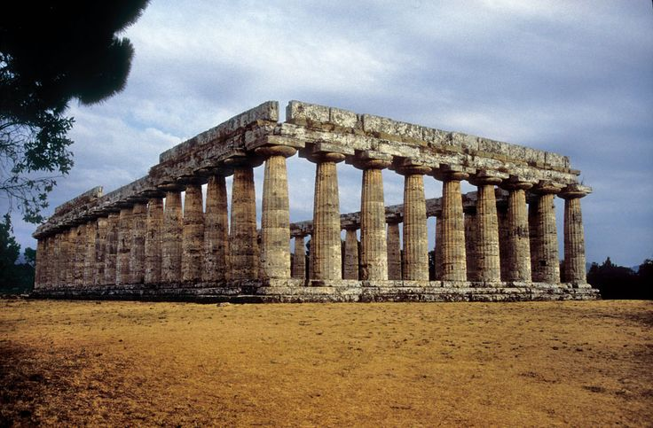 Temple of Hera I (Basilica) Paestum. 550 BC. Archaic period. We can often descibe temple by how many columns it has. The columns bulge (called entasis). Gives the building a sense of weight. Early doric temples have this.