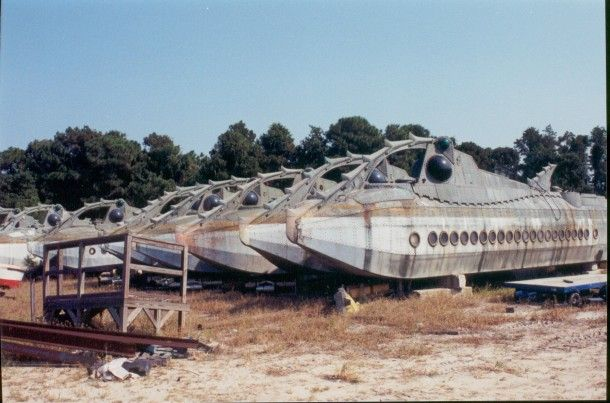 Abandoned Subs from Disney's (now demolished) 20k Leagues ride.   The subs were parted out and sold on ebay to Disney enthusiasts. What was left was ground down and buried in sealed containers due to the hight lead content in the paint.   http://www.20kride.com/photos_after.html