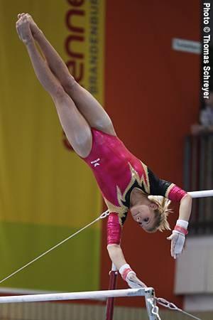 gymnast on uneven bars, women's gymnastics WAG
