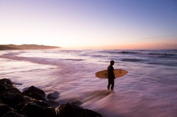 Hamish waits for the sets before paddling out for the morning at St Clair Beach, Dunedin, New Zealand. - Buy this print | Box of Light - Surf + Lifestyle + Mountains
