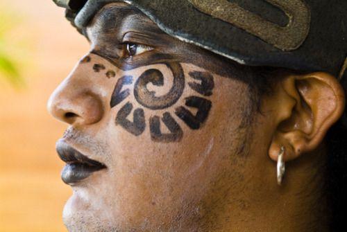A profile portrait of a man dressed as a Mayan warrior. Location:Quintana Roo, Yucatan Peninsula, Mexico.