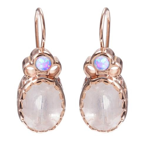 "Inspired by the history, these enchanting earrings combine radiant moonstone gems with color-changing opals and luscious rose gold.  Arik Kastan's ""Vintage Rose Gold"" blend emanates gold used in Victorian times.  at Greenwich Jewelers, $995"