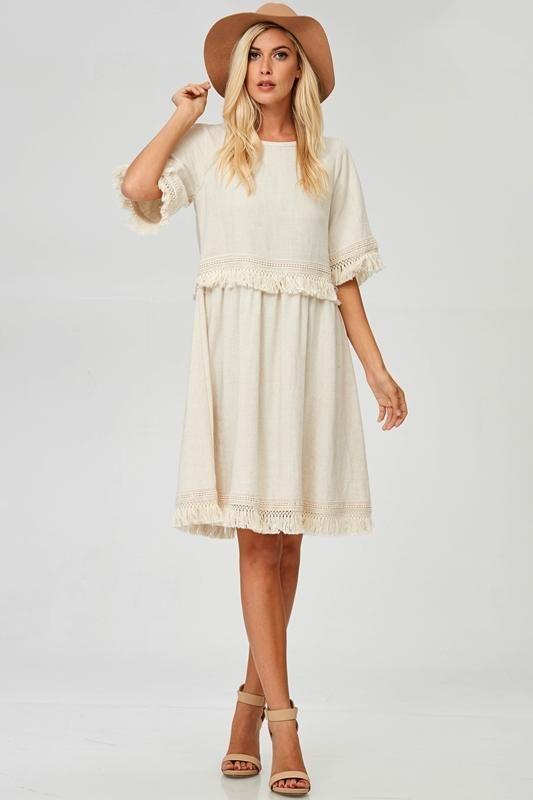 d98c599edd30 A stunning cream colored dress featuring tassel details on the sleeves,  waistline, hemline. Small- 2-4 Medium- 6-8 Large- 10-12