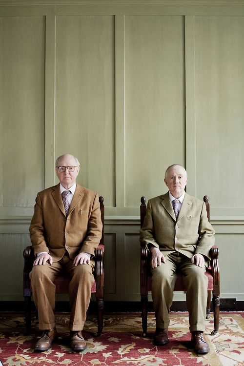 Gilbert Prousch,(born 17 September 1943 in San Martin de Tor, Italy) and George Passmore (born 8 January 1942 in Plymouth, United Kingdom) are two artists who work together as a collaborative duo called Gilbert & George. They are known for their distinctive and highly formal appearance and manner and also for their brightly coloured graphic-style photo-based artworks.