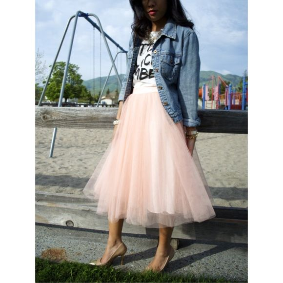 Pink Tulle skirt 4 layer pink tulle skirt length 26.5 inches. Sateen look waist band. NWOT Although skirt has never been worn, inside band is a little twisted. There is no label but skirt was purchased as one size fits all. Fits more of a xs-medium. no more photos no trades no questions from non serious buyers or you will be blocked no lowball offers do not bundle items unless you intend on purchasing no price comments ✔️I ship the next day ✔️firm price Skirts