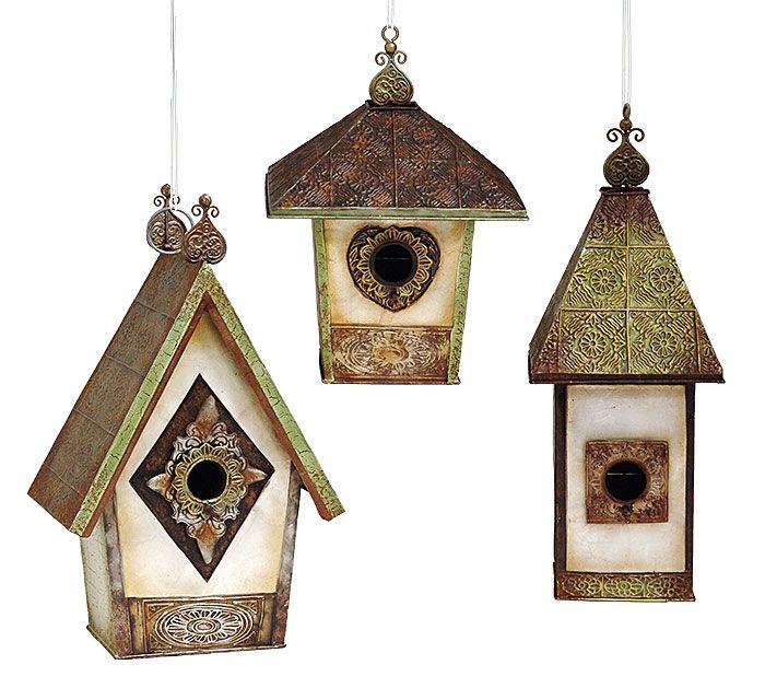 No garden is complete without unique birdhouses! #burtonandburton #birdhouses #garden