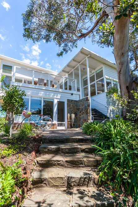great beach house, love the crazy paving and all the white weatherboards. via coastal-style.blogspot.com.au