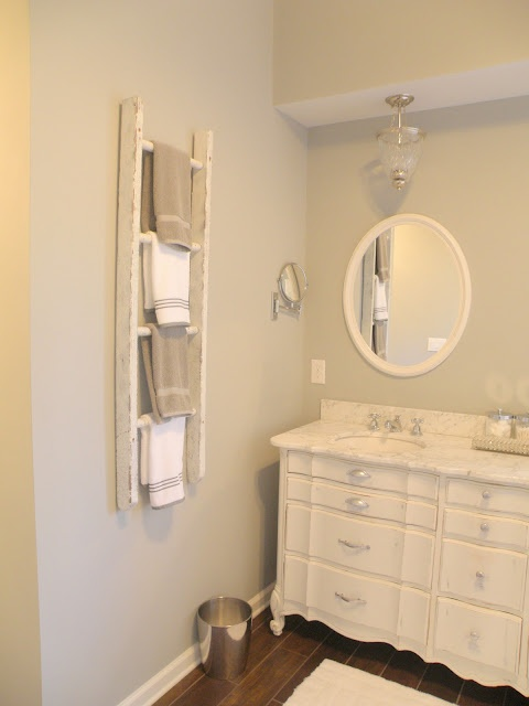 Grey Walls, dresser turned vanity, ladder towel hanger. Great ideas!