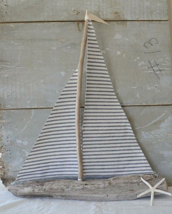 Grey and white driftwood sail boat.