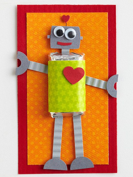A fun-sized candy bar wrapped in scrapbook paper makes the body of this cute little love-bot card!