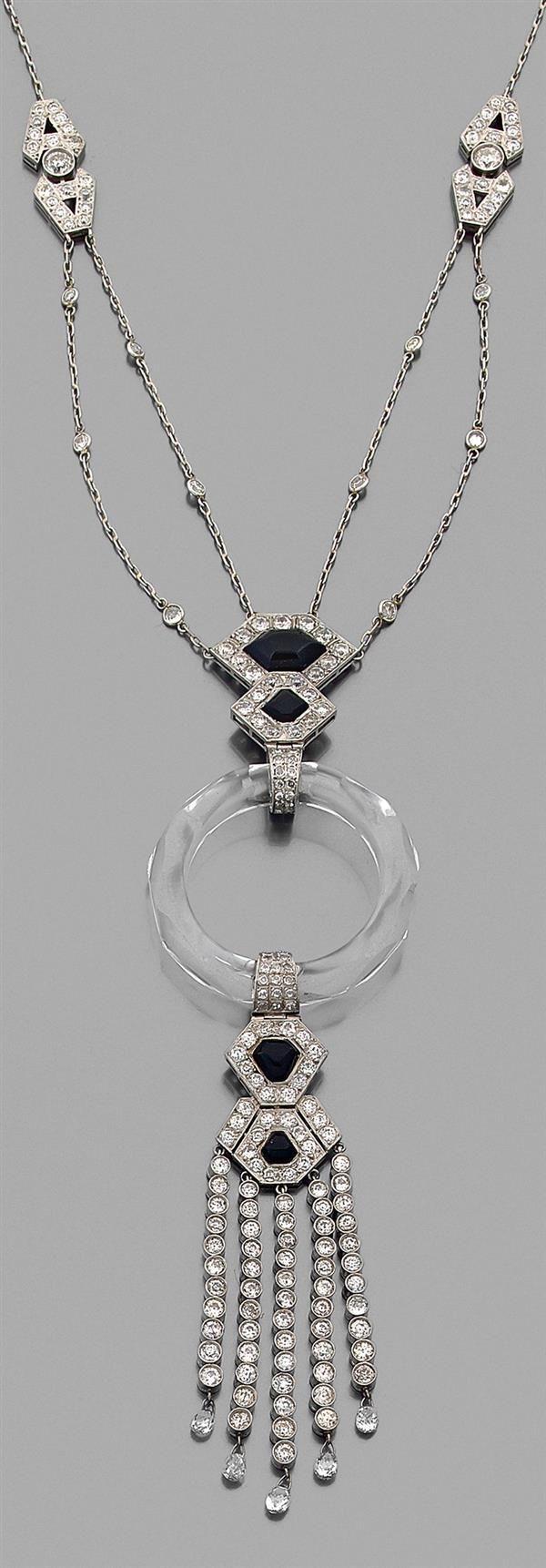 An Art Deco platinum, rock crystal, onyx and diamond necklace, 1930s.