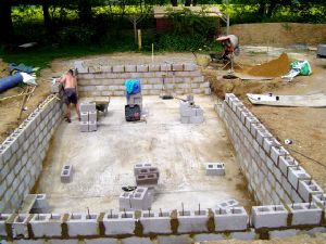 Diy with cinder blocks excavate site lay reinforced - Cinder block swimming pool construction ...