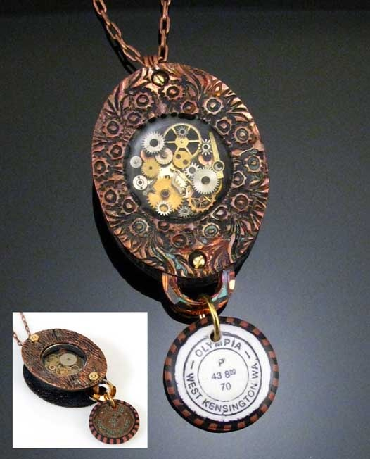 "Metal Clay Contest Winner:  Lisa Pavelka's design ""Frozen In Time"" uses UV resin, a soldered bezel, watch parts and COPPRclay (copper clay) along with Swarovski crystal."