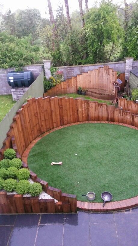 Circular garden, artificial grass, railway sleepers, garden bench