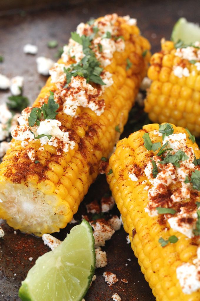 Mexican Corn On The Cob. Delicious freshly cooked corn topped with chilli, lime and feta or cojita cheese.