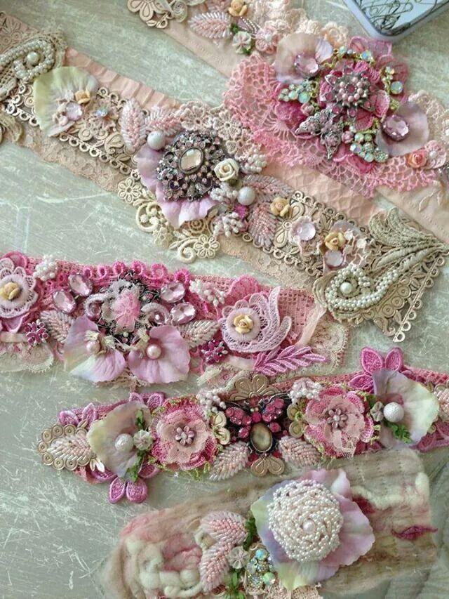 Beautiful fabric cuff bracelets ~ pins, brooches, ribbon, and fabric sewn to a lace base.