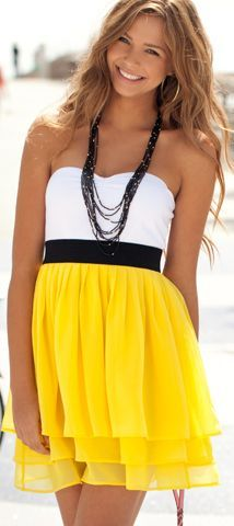 Pretty dress on a pretty girl.Two-tone dress,  black belt. White  yellow