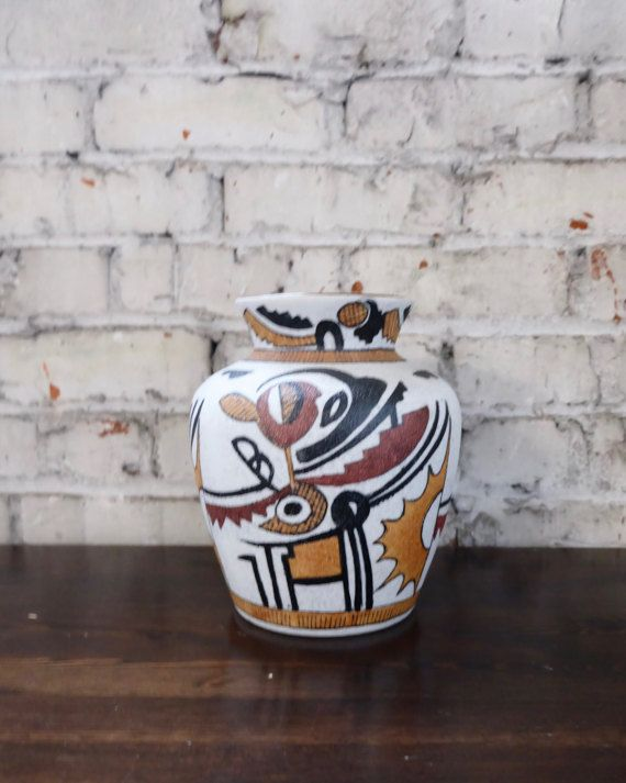 Check out this item in my Etsy shop https://www.etsy.com/listing/510956993/southwestern-vase-bird-stamped-pablo