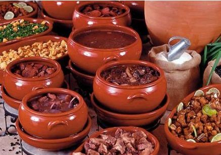 FEIJOADA is a stew of beans with beef and pork. As a tradition, it is served as lunch on Saturdays with some shots of Caipirinha.