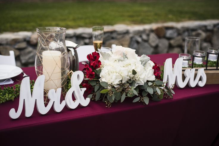 White Hydrangea, Burgundy Alstroemeria & Eucalyptus foliage Sweetheart table centerpiece designed by Pennie's Bloomers.