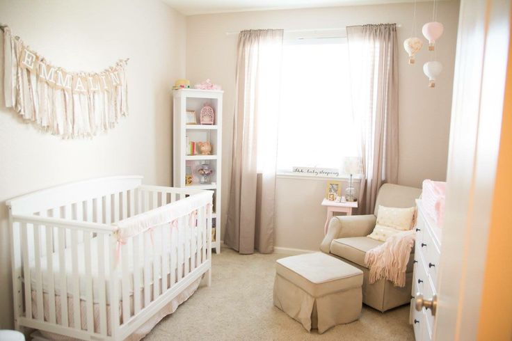Subtle pink gold and beige baby girl nursery
