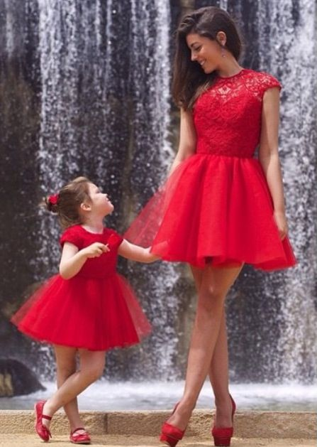 Mom and daughter-- Matching red outfit.